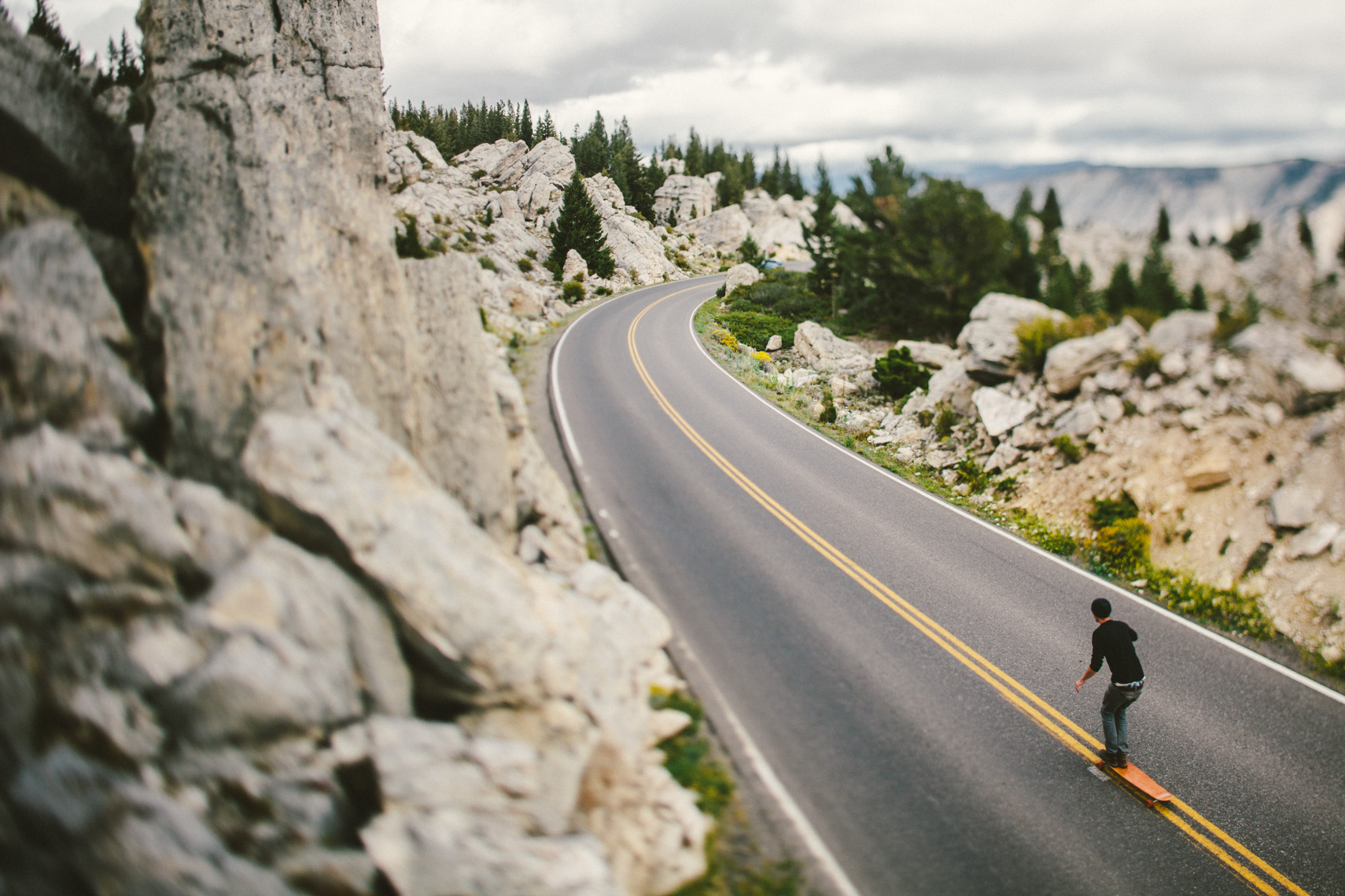 Adventure and outdoor lifestyle photogaph by Forest Woodward long boarding in Yellowstone National Park USA