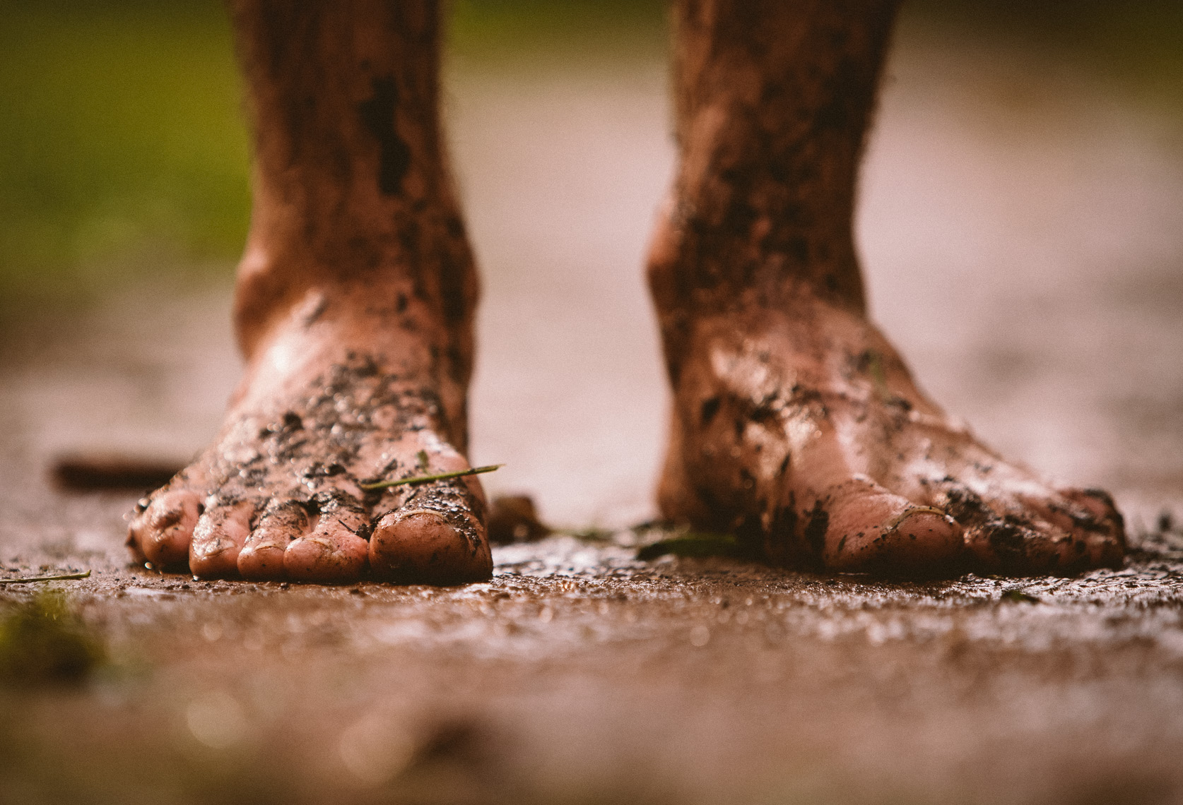 Adventure and outdoor lifestyle photogaph by Forest Woodward barefoot runner muddy feet