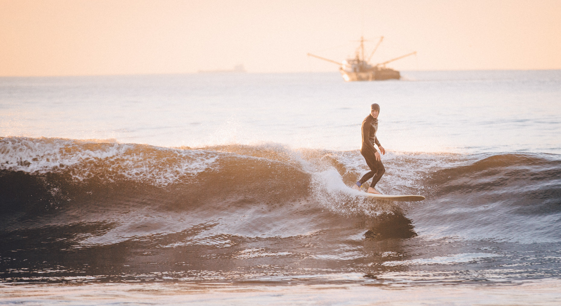 Adventure and outdoor lifestyle photogaph by Forest Woodward surfing Rockaway Beach NYC