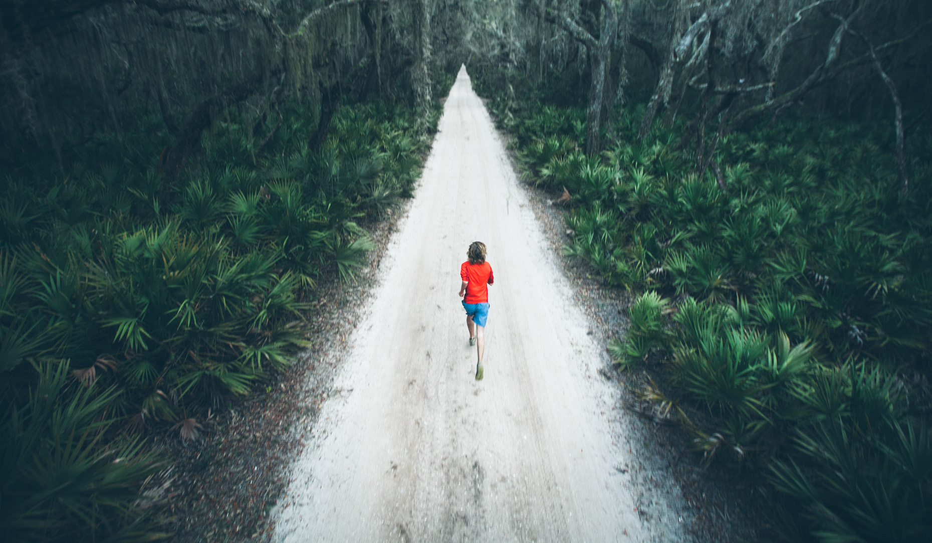Adventure and outdoor lifestyle photogaph by Forest Woodward Canyon Woodward Running on Cumberland Island off the coast of Georgia