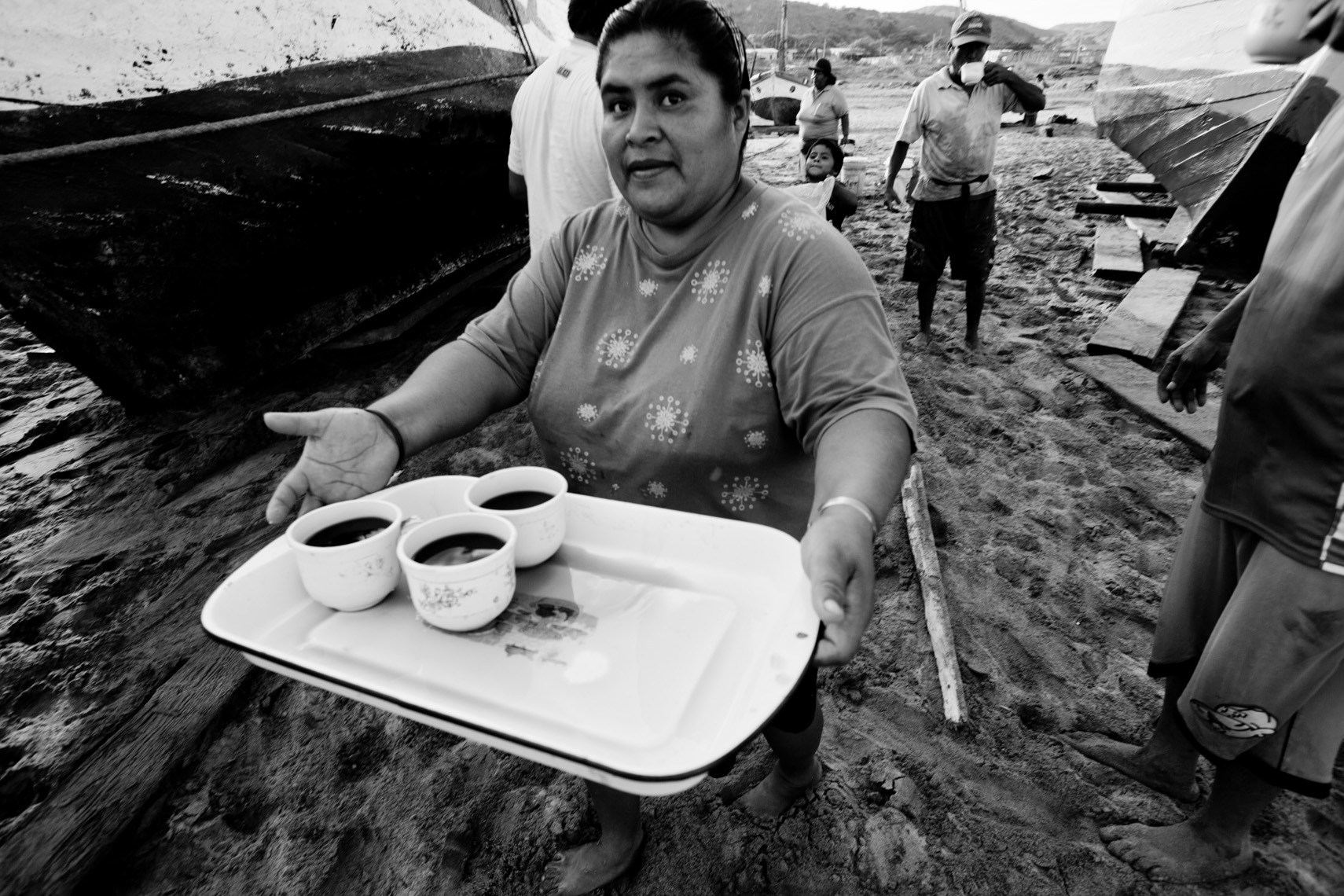 Woman serving coffee in small fishing village in Lobitos Peru, photograph by Forest Woodward