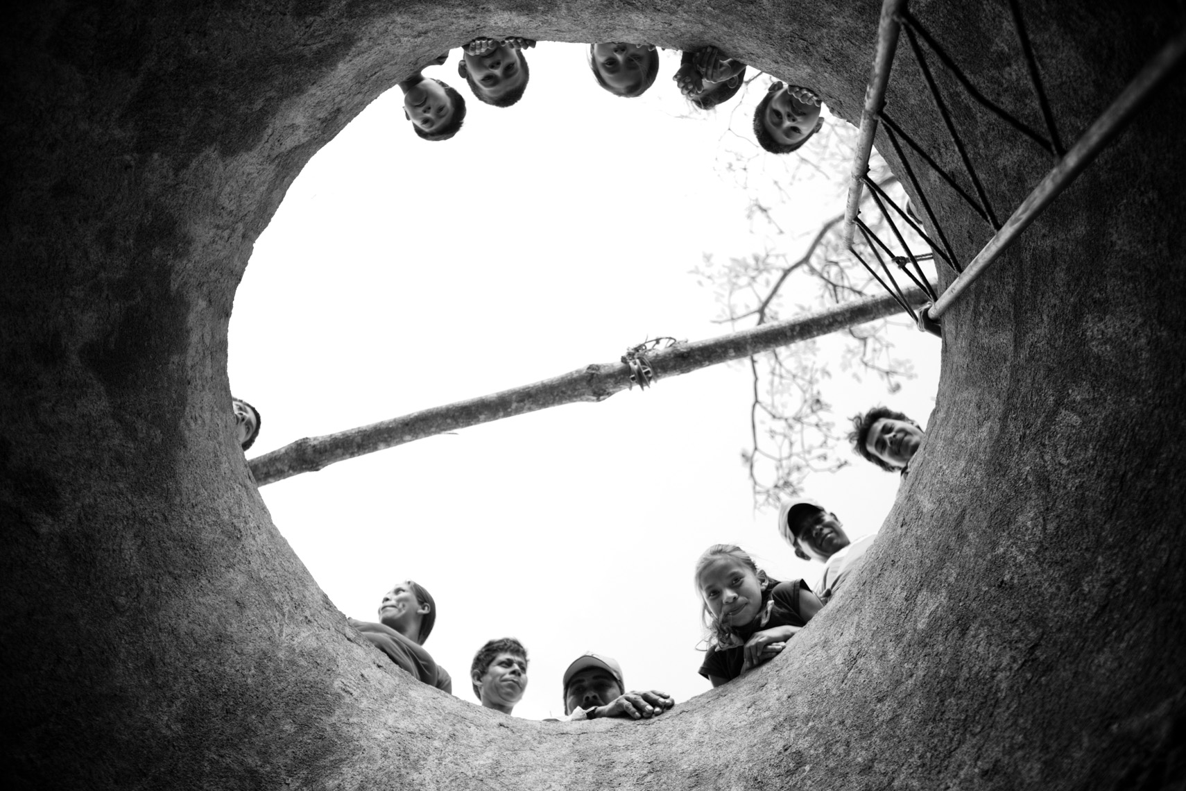 Children admiring a freshly dug well by El Por Venir in Nicaragua, photograph of travel by Forest Woodward