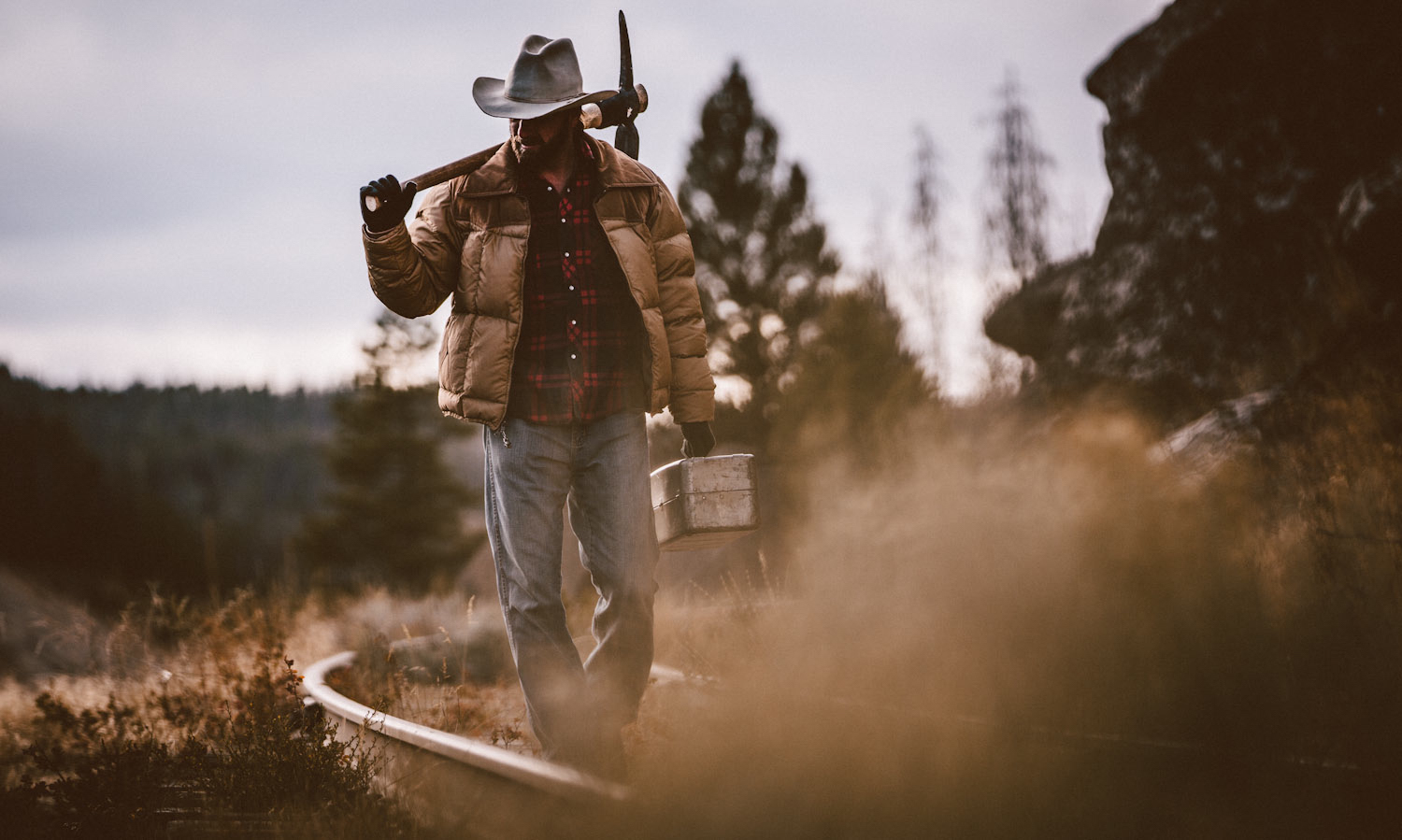 Marlboro man in Montana riding horse for Agloves campaign by Forest Woodward