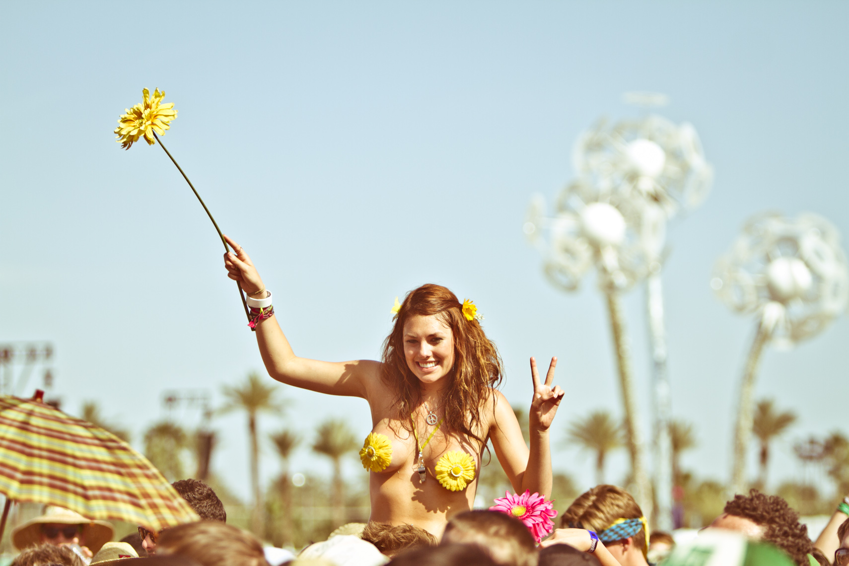 Topless girl at Coachella muic festival photograph by Forest Woodward