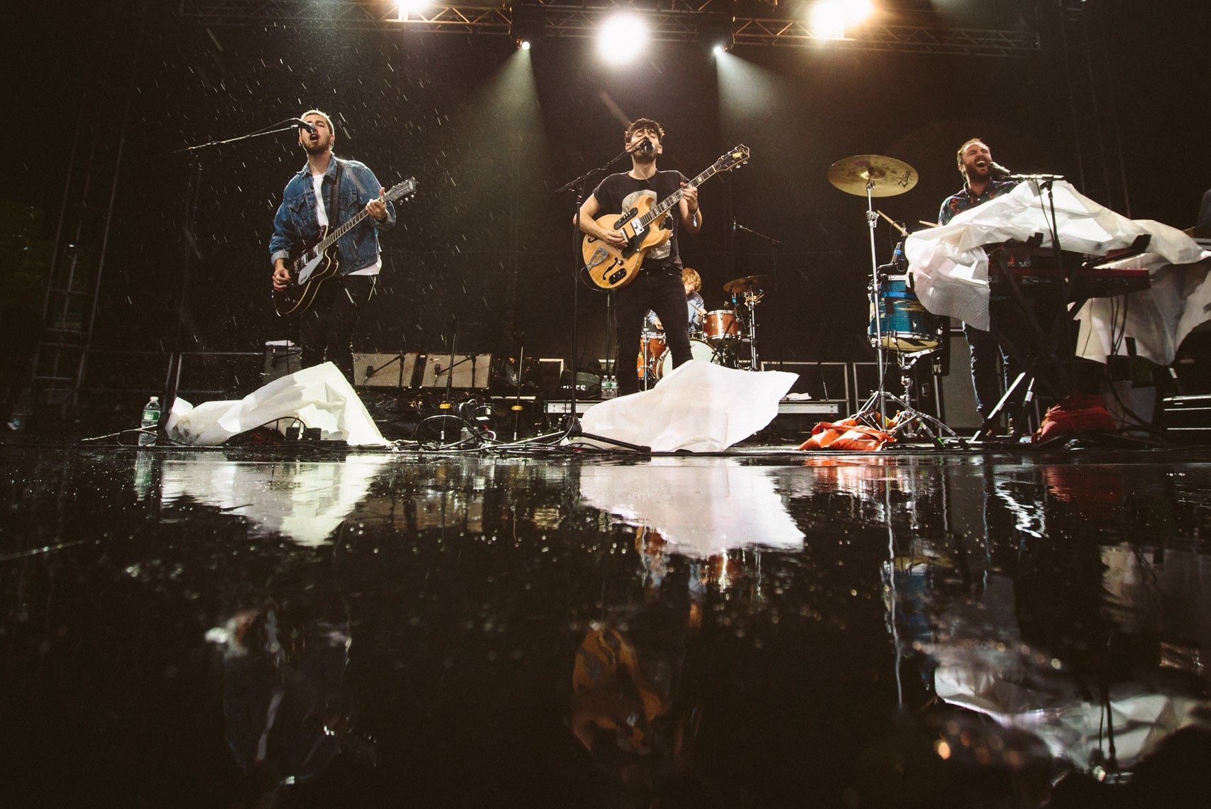 Local Natives at Governors ball playing in the Rain photographed by Forest Woodward